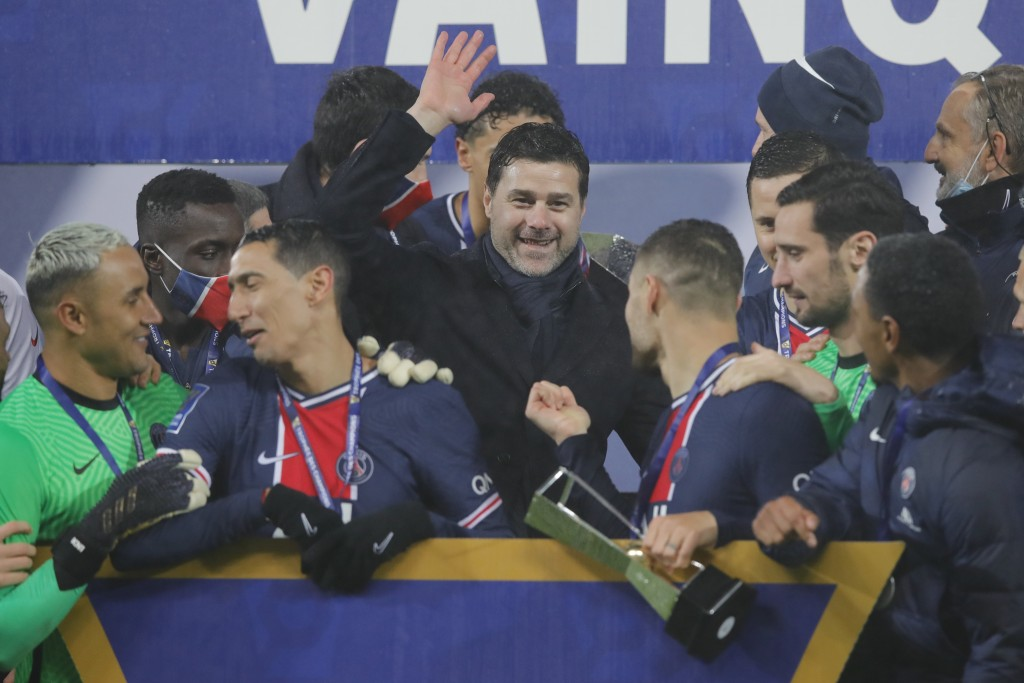 PSG's head coach Mauricio Pochettino, center, and PSG players celebrate with the trophy after the Champions Trophy soccer match between Paris Saint-Ge...