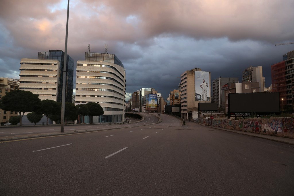 A street is empty of cars during a lockdown aimed at curbing the spread of the coronavirus, in Beirut, Lebanon, Friday, Jan. 15, 2021. Lebanon's parli...