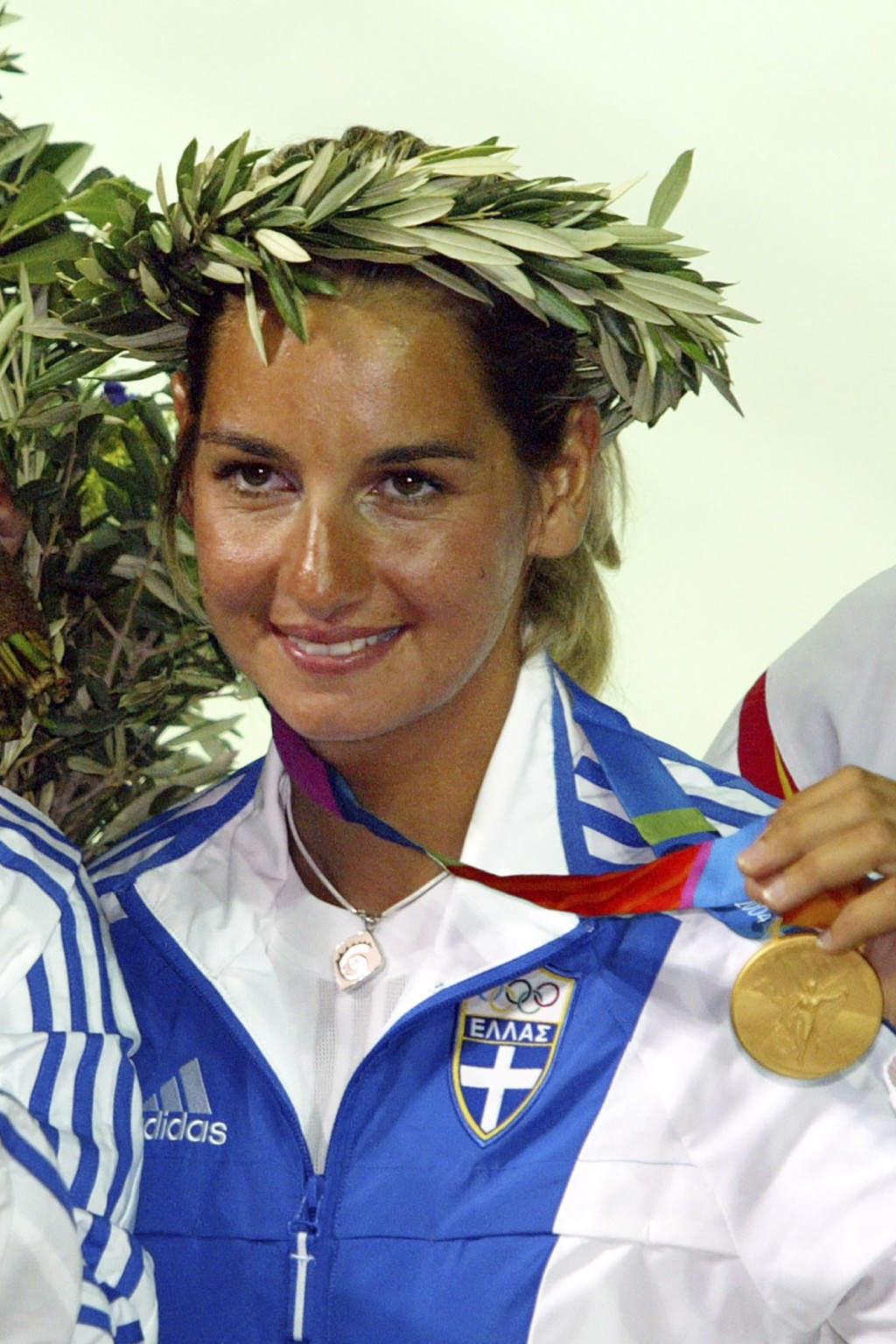 FILE - In this Saturday, Aug. 21, 2004 file photo, Greek 470 class skipper Sofia Bekatorou, displays her gold medal during the medal ceremony of the w...