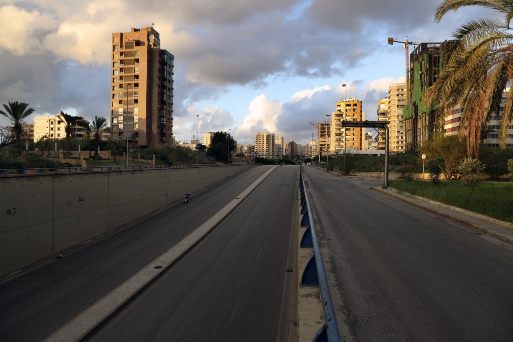 A highway is empty of cars during a lockdown aimed at curbing the spread of the coronavirus, in Beirut, Lebanon, Friday, Jan. 15, 2021. Lebanon's parl...