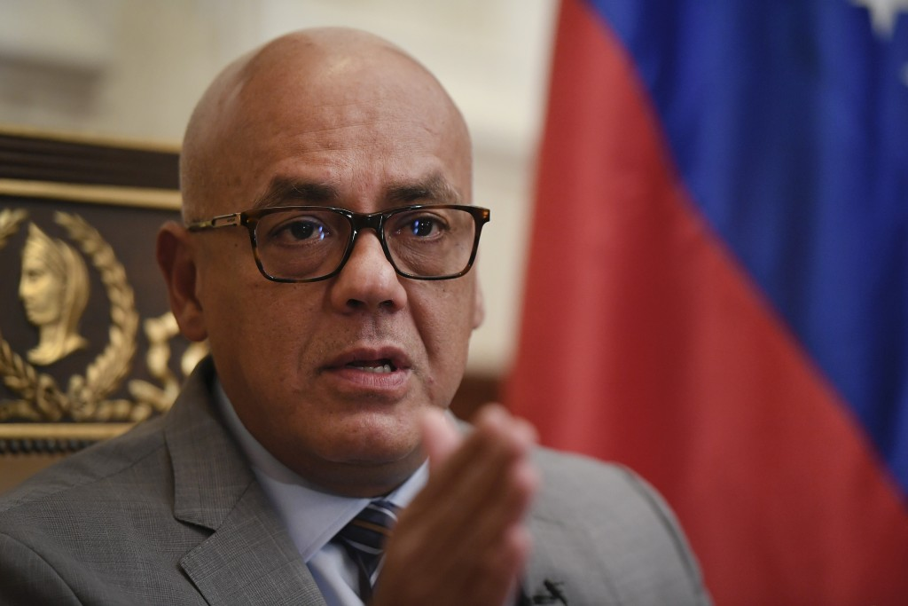 National Assembly President Jorge Rodriguez gives an interview at Congress in Caracas, Venezuela, Friday, Jan. 15, 2021. Rodriguez said he's hopeful t...