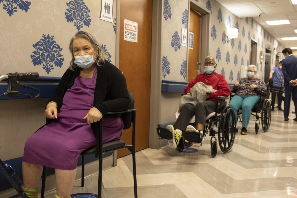 Nursing home residents make a line for the coronavirus disease (COVID-19) vaccine at Harlem Center for Nursing and Rehabilitation, a nursing home faci...