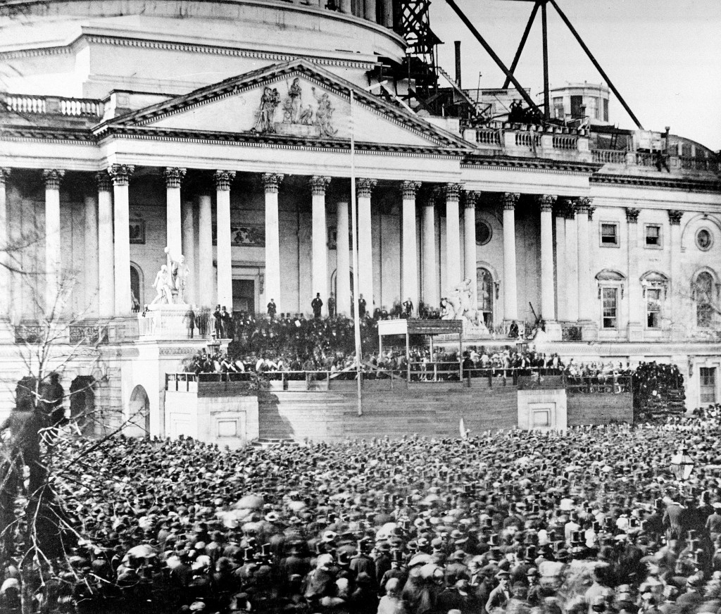 FILE - In this March 4, 1961 file image, President Abraham Lincoln stands under cover at center of Capitol steps during his inauguration in Washington...