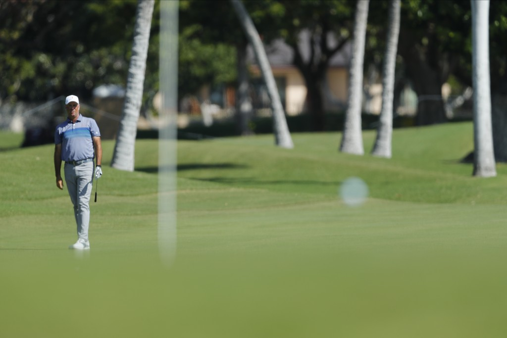 Stewart Cink watches his ball land on the 18th green during the second round of the Sony Open golf tournament Friday, Jan. 15, 2021, at Waialae Countr...