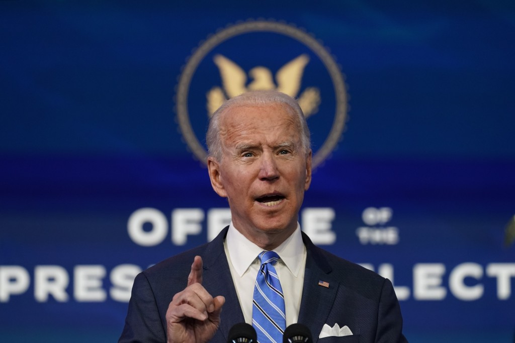 President-elect Joe Biden speaks during an event at The Queen theater, Thursday, Jan. 14, 2021, in Wilmington. Biden's plan to scrap President Donald ...