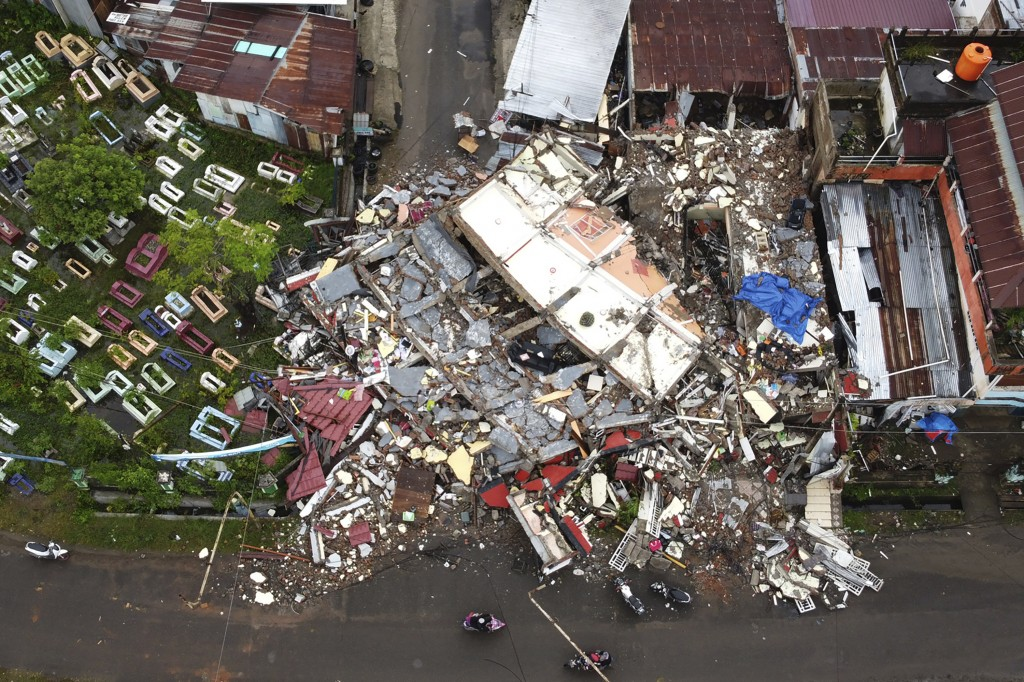 A building is seen badly damaged following an earthquake in this aerial photo taken using a drone in Mamuju, West Sulawesi, Indonesia, Saturday, Jan. ...