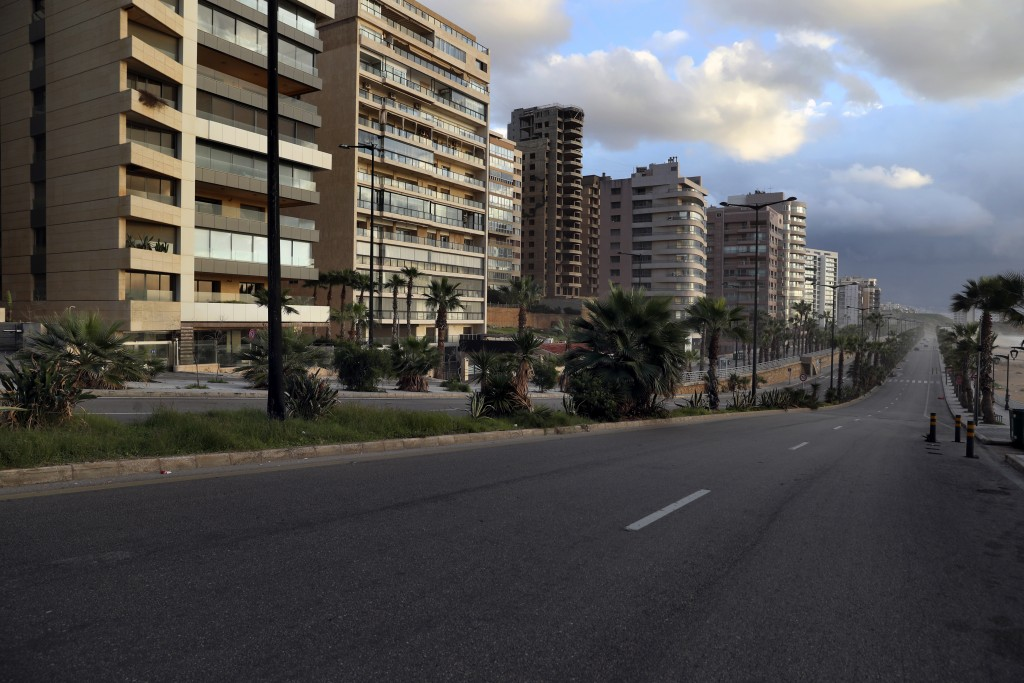 A street is almost empty of cars during an 11-day nationwide shutdown aimed at curbing the spread of the coronavirus, in Beirut, Lebanon, Friday, Jan....