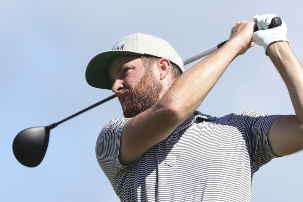Chris Kirk follows his shot off the first tee during the third round at the Sony Open golf tournament Saturday, Jan. 16, 2021, in Honolulu. (AP Photo/...