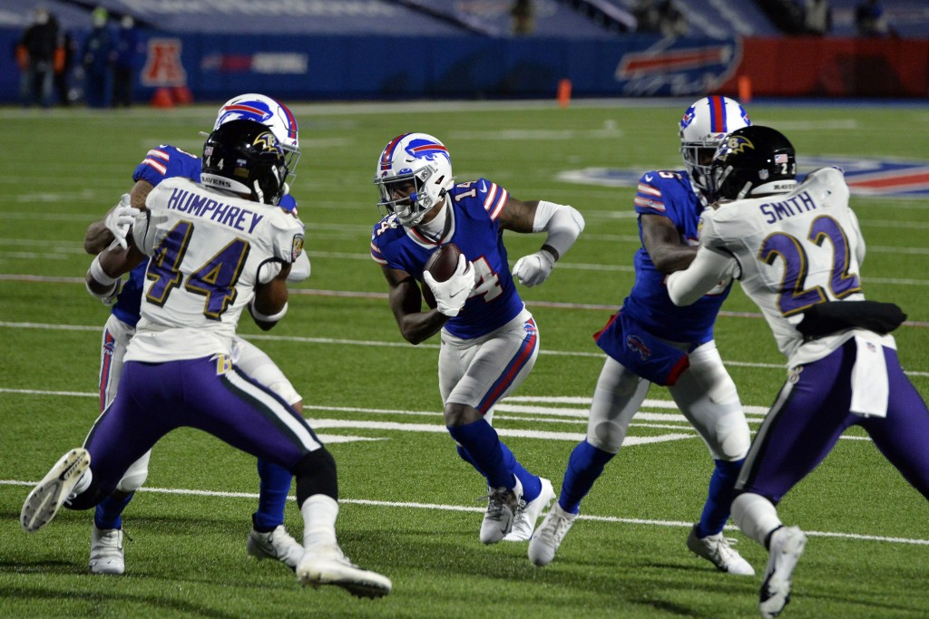 Buffalo Bills wide receiver Stefon Diggs (14) runs past Baltimore Ravens' Marlon Humphrey (44) and Jimmy Smith (22) for a touchdown during the second ...