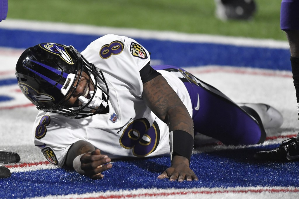 Baltimore Ravens quarterback Lamar Jackson (8) reacts after being injured during the second half of an NFL divisional round football game against the ...