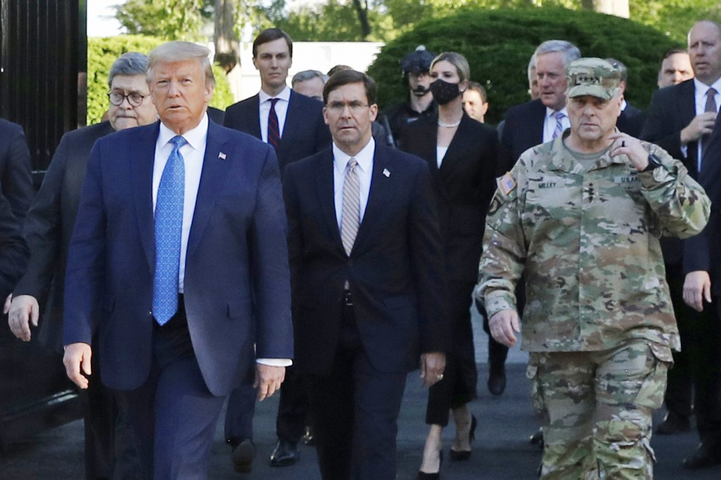 FILE - In this June 1, 2020 file photo, President Donald Trump departs the White House to visit outside St. John's Church, in Washington. Walking behi...