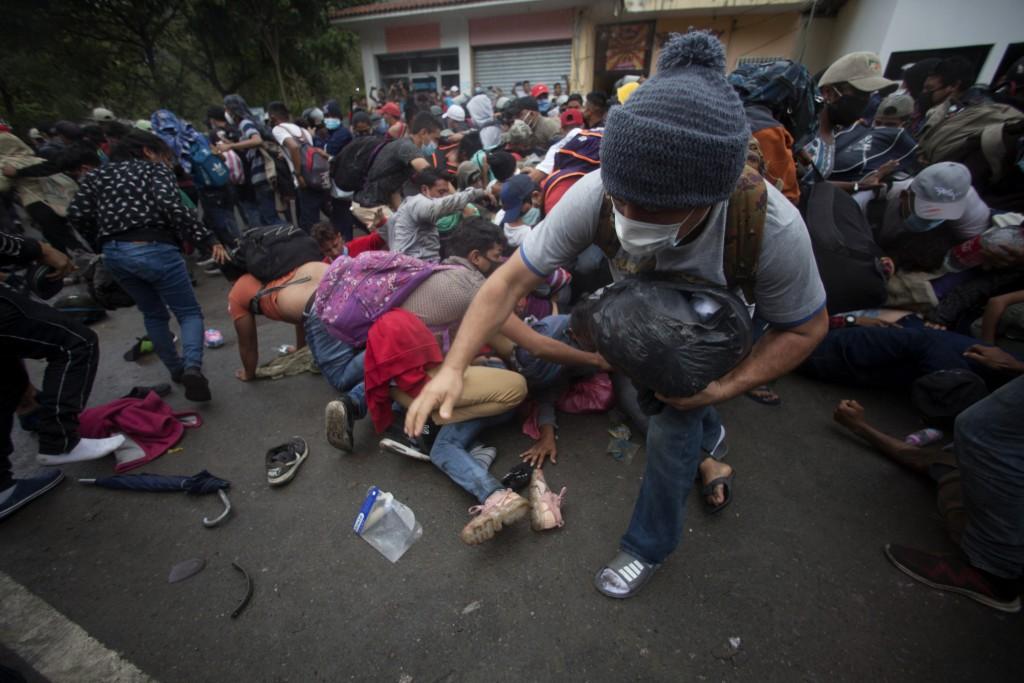 Honduran migrants hoping to reach the U.S. scramble to cross the border patrolled by Guatemalan soldiers, in El Florido, Guatemala, Saturday, Jan. 16,...