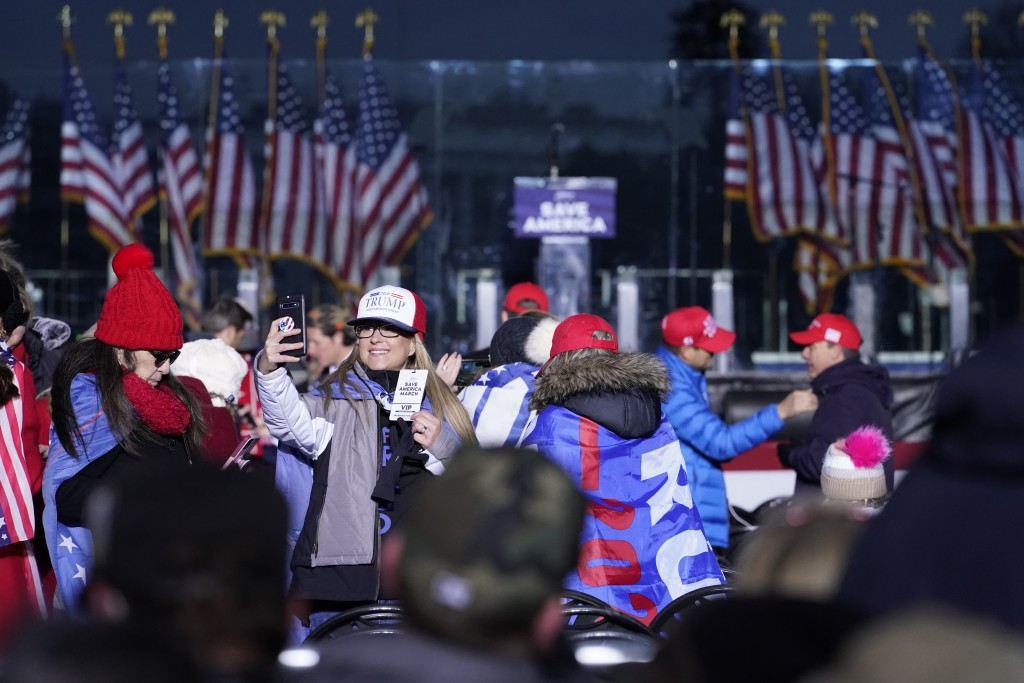 FILE - In this Jan. 6, 2021 file photo people arrive to attend a rally in support of President Donald Trump. An AP review of records finds that member...