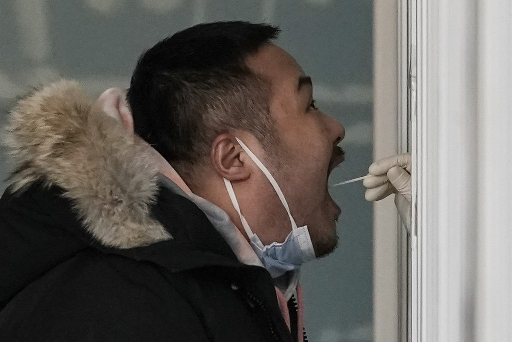 A man gets a swab for the coronavirus test at a hospital in Beijing, Sunday, Jan. 17, 2021. The coronavirus was found on ice cream produced in eastern...