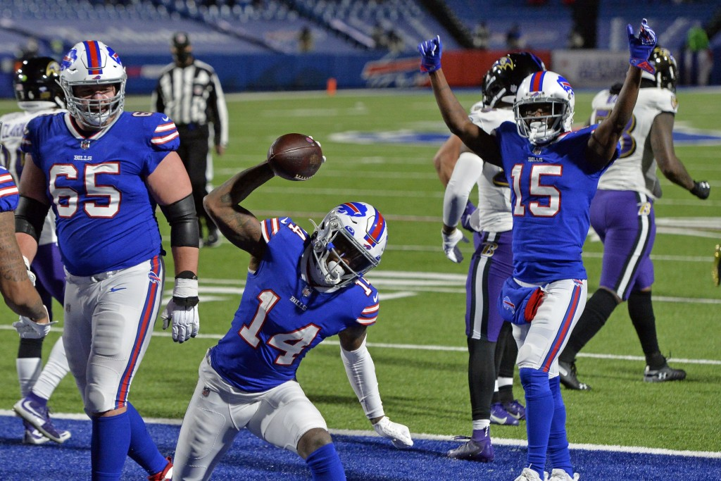 Buffalo Bills wide receiver Stefon Diggs (14) celebrates after scoring a touchdown during the second half of an NFL divisional round football game aga...