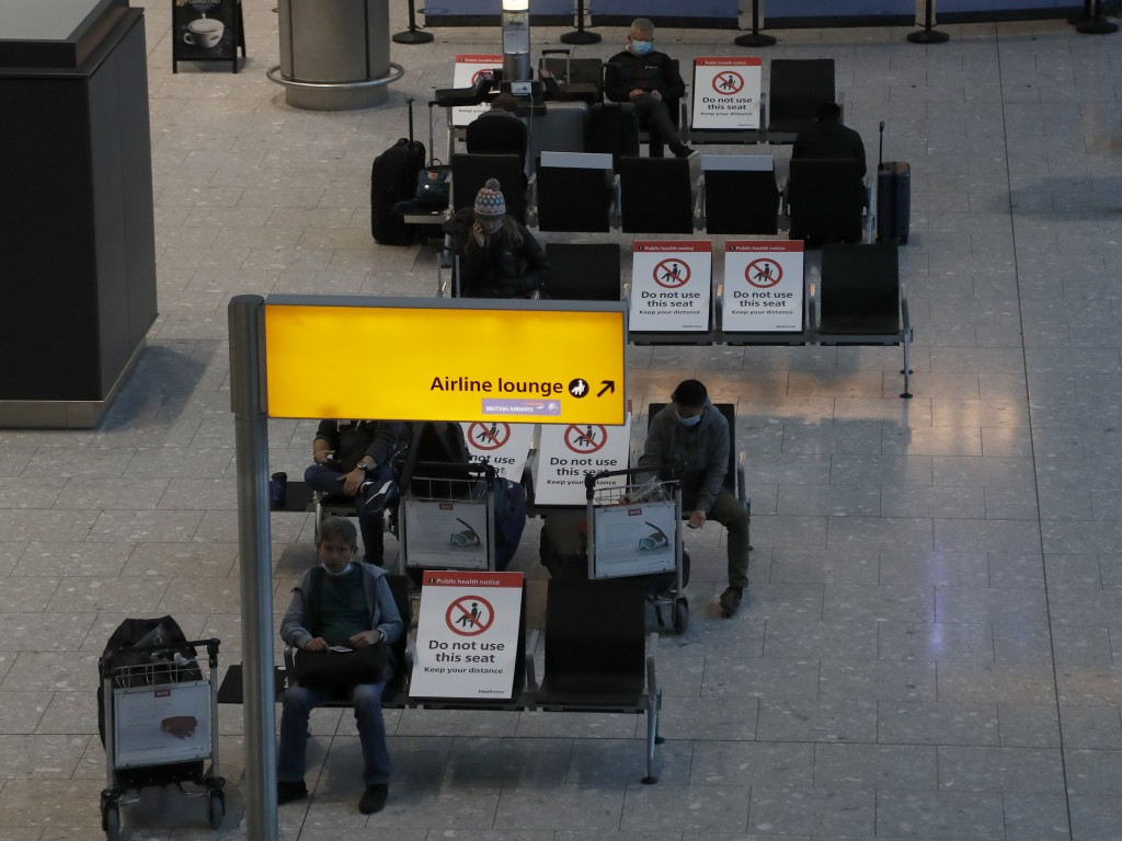 Travellers wait for their Covid-19 test results at Heathrow Airport in London, Sunday, Jan. 17, 2021. The UK will close all travel corridors from Mond...