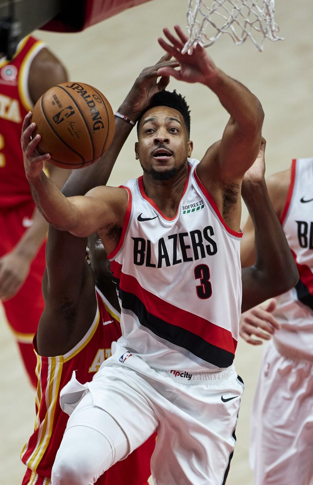 Portland Trail Blazers guard CJ McCollum shoots against the Atlanta Hawks during the first half of an NBA basketball game in Portland, Ore., Saturday,...