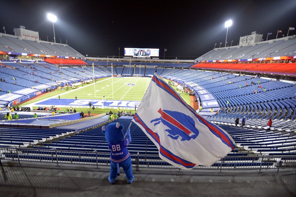 Buffalo Bills fans leave Bills Stadium as a mascot waves a flag after an NFL divisional round football game against the Baltimore Ravens Saturday, Jan...