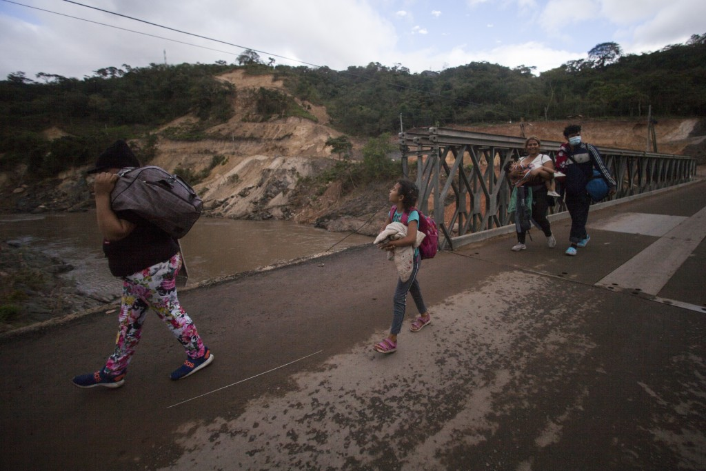 Migrants hoping to reach the distant U.S. border walk along a highway, in Jocotan, Guatemala, Saturday, Jan. 16, 2021. Honduran migrants pushed their ...
