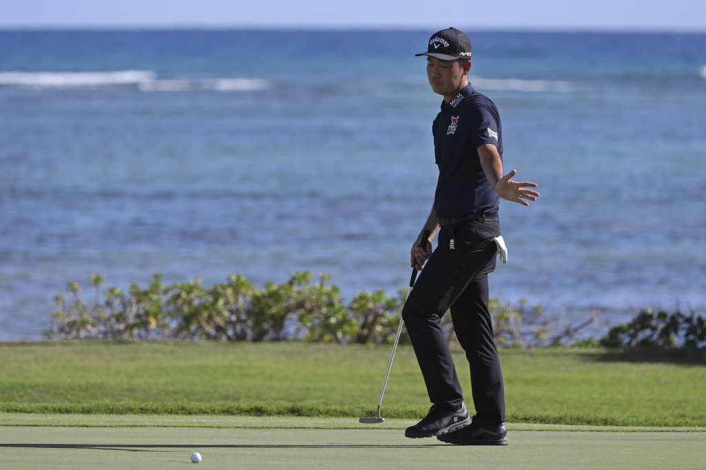 Kevin Na reacts to his putt on the 17th green during the third round at the Sony Open golf tournament Saturday, Jan. 16, 2021, in Honolulu. (AP Photo/...