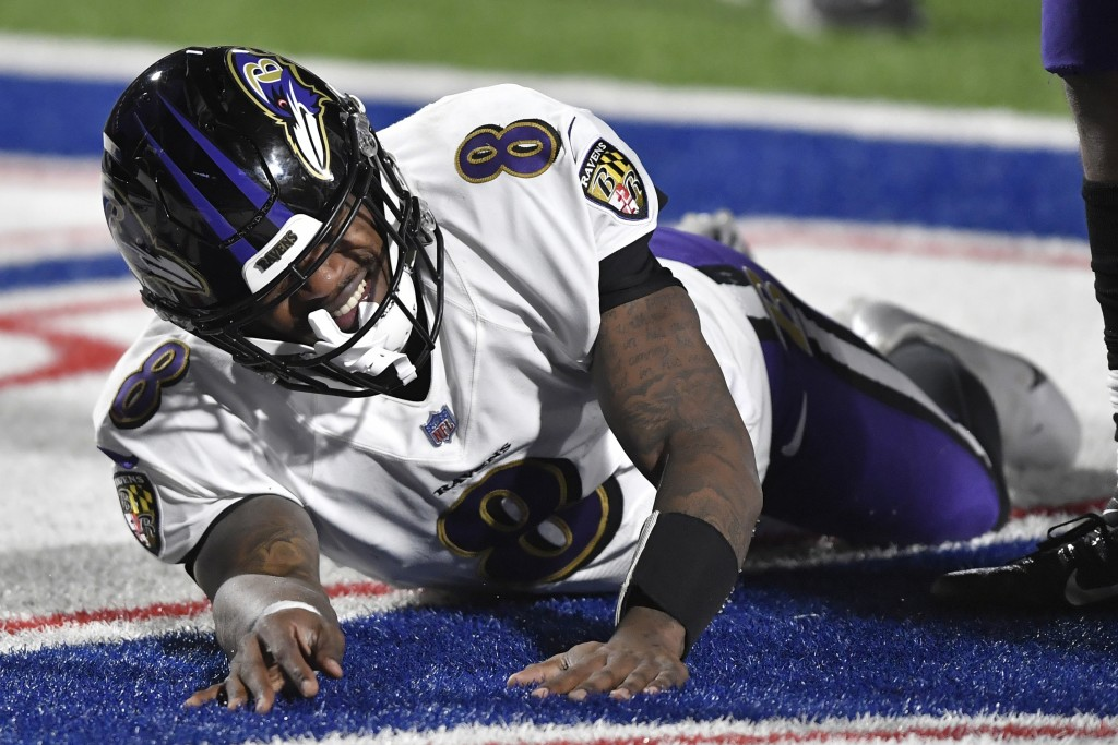 Baltimore Ravens quarterback Lamar Jackson (8) reacts after getting hurt during the second half of an NFL divisional round football game against the B...