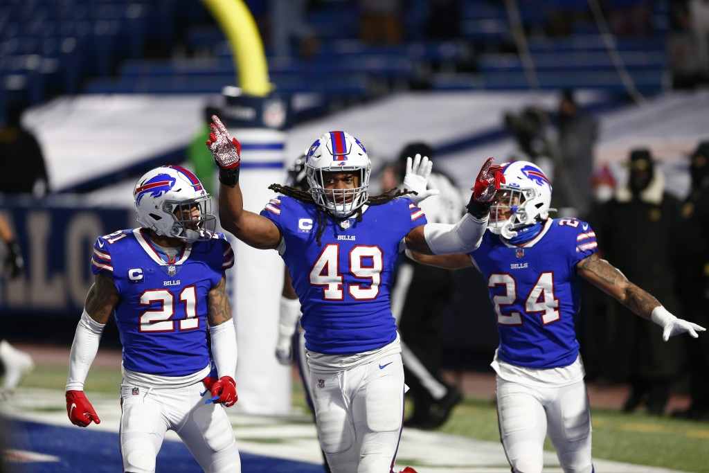 Buffalo Bills middle linebacker Tremaine Edmunds (49) celebrates with Jordan Poyer (21) and Taron Johnson (24) during the second half of an NFL divisi...