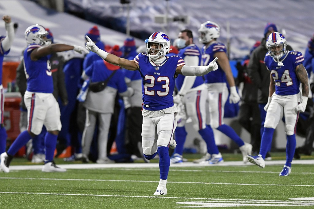 Buffalo Bills' Micah Hyde (23) celebrates with teammates after an NFL divisional round football game against the Baltimore Ravens Saturday, Jan. 16, 2...