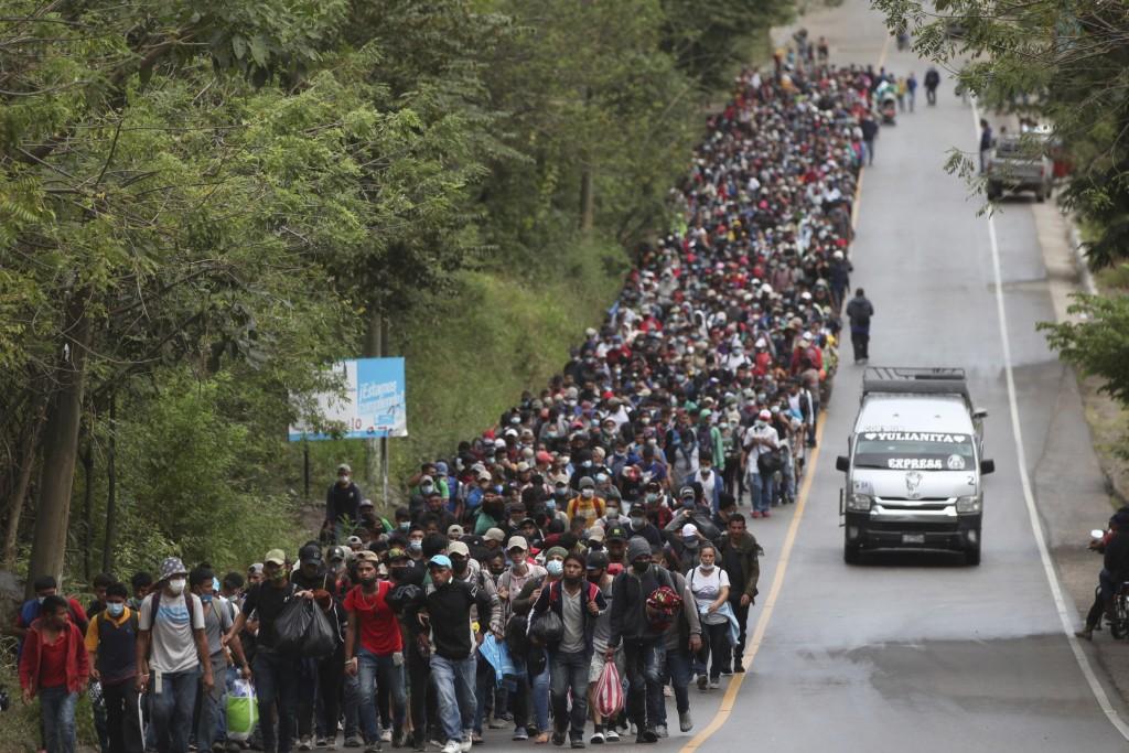 Migrants hoping to reach the U.S. border walk alongside a highway in Chiquimula, Guatemala, Saturday, Jan. 16, 2021. Honduran migrants pushed their wa...