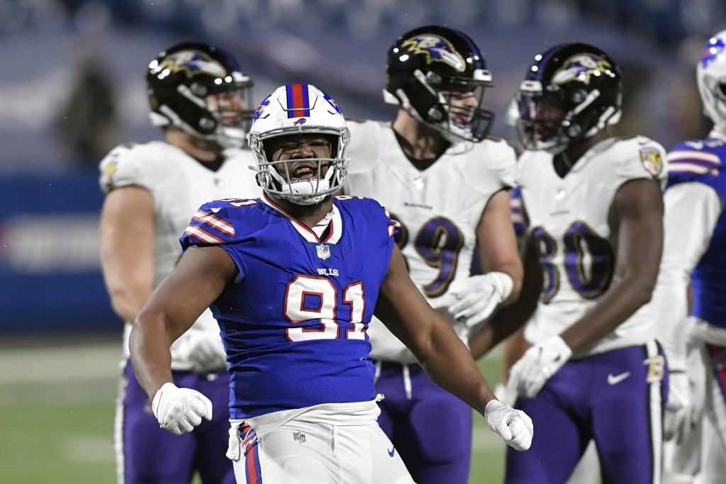 Buffalo Bills defensive tackle Ed Oliver (91) celebrates after stopping Baltimore Ravens' J.K. Dobbins in the backfield during the second half of an N...