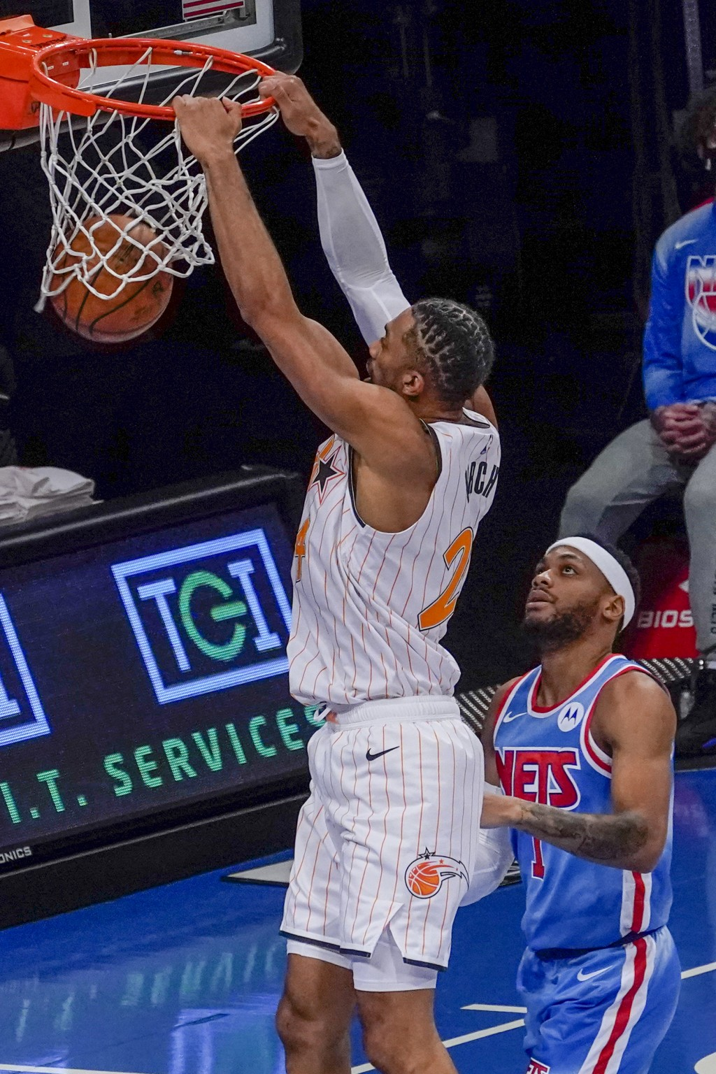 Orlando Magic center Khem Birch (24) dunks past Brooklyn Nets guard Bruce Brown during the first half of an NBA basketball game, Saturday, Jan. 16, 20...