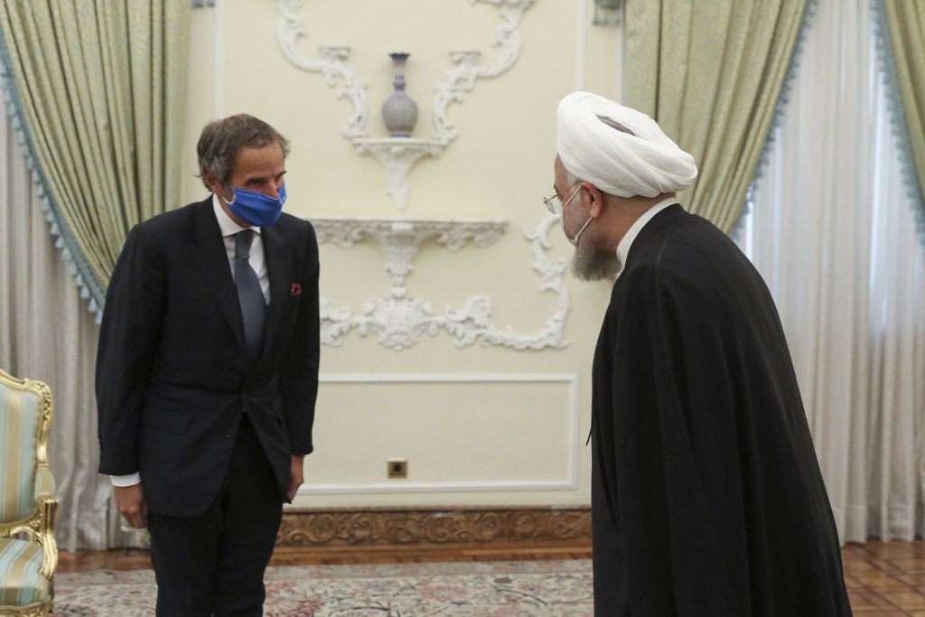 FILE - In this Aug. 26, 2020 file photo, released by the official website of the office of the Iranian Presidency, President Hassan Rouhani, right, we...