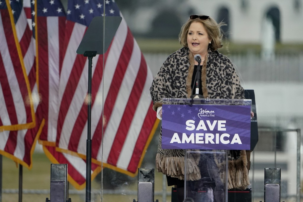 FILE - In this Jan. 6, 2021 file photo Amy Kremer, Chairwoman of Women for America First, speaks in Washington, at a rally in support of President Don...