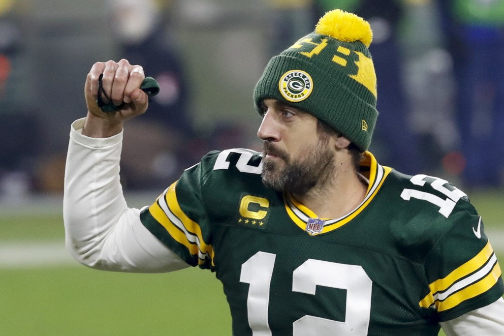Green Bay Packers quarterback Aaron Rodgers pumps his fist after an NFL divisional playoff football game against the Los Angeles Rams Saturday, Jan. 1...