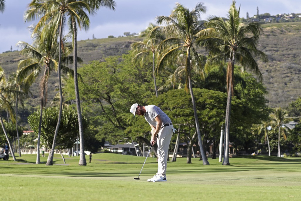 Chris Kirk putts on the 13th green during the third round at the Sony Open golf tournament Saturday, Jan. 16, 2021, in Honolulu. (AP Photo/Marco Garci...