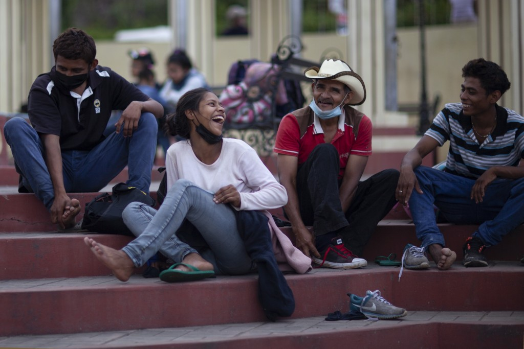 Migrants hoping to reach the distant U.S. border rest on the side of a highway, in Jocotan, Guatemala, Saturday, Jan. 16, 2021. Honduran migrants push...