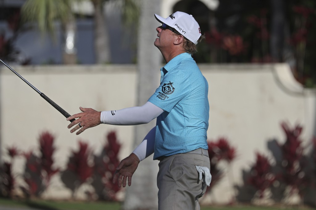 Charley Hoffman reacts to his putt on 16th green during the third round at the Sony Open golf tournament Saturday, Jan. 16, 2021, in Honolulu. (AP Pho...