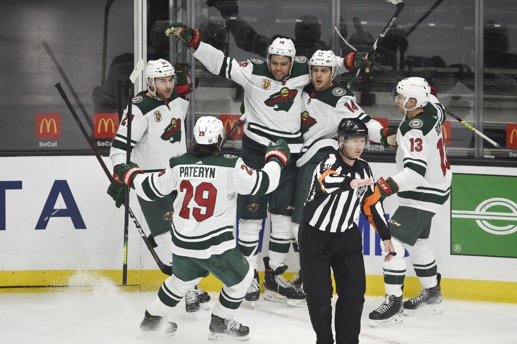 Minnesota Wild center Joel Eriksson Ek, second from right, celebrates his goal with Carson Soucy, Greg Pateryn, Jordan Greenway and Nick Bonino, from ...