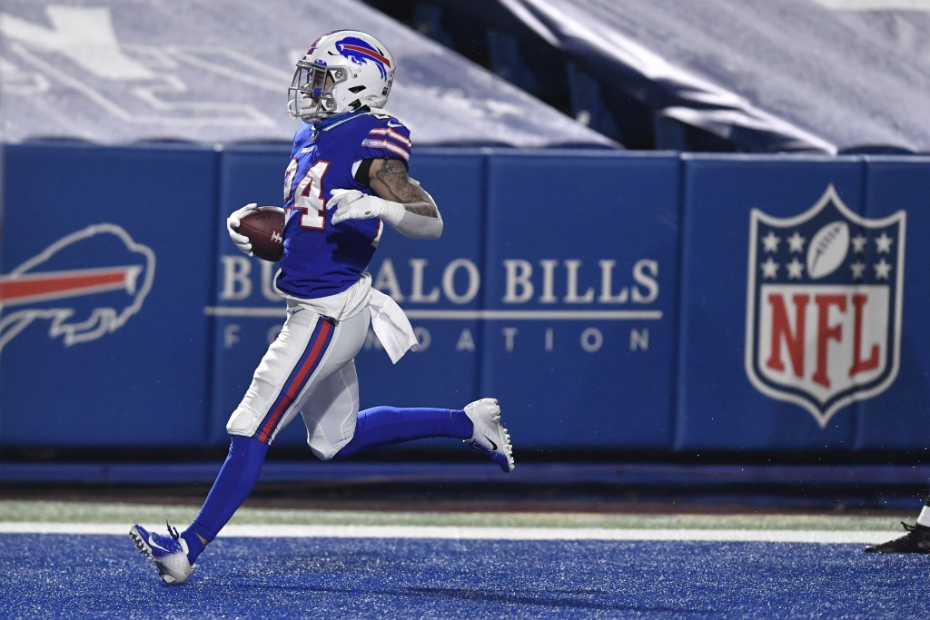 Buffalo Bills' Taron Johnson (24) returns an interception for a touchdown during the second half of an NFL divisional round football game against the ...