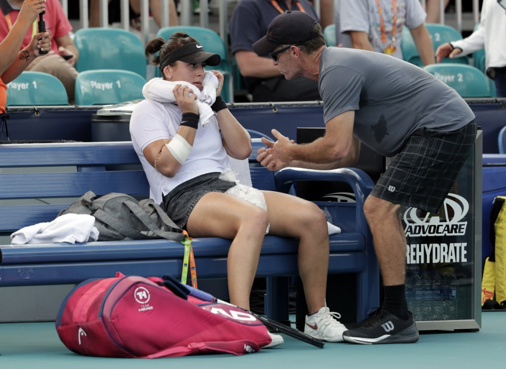 FILE - In this March 21, 2019 file photo, Bianca Andreescu, of Canada, left, talks with her coach Sylvain Bruneau during her match against Irina Camel...