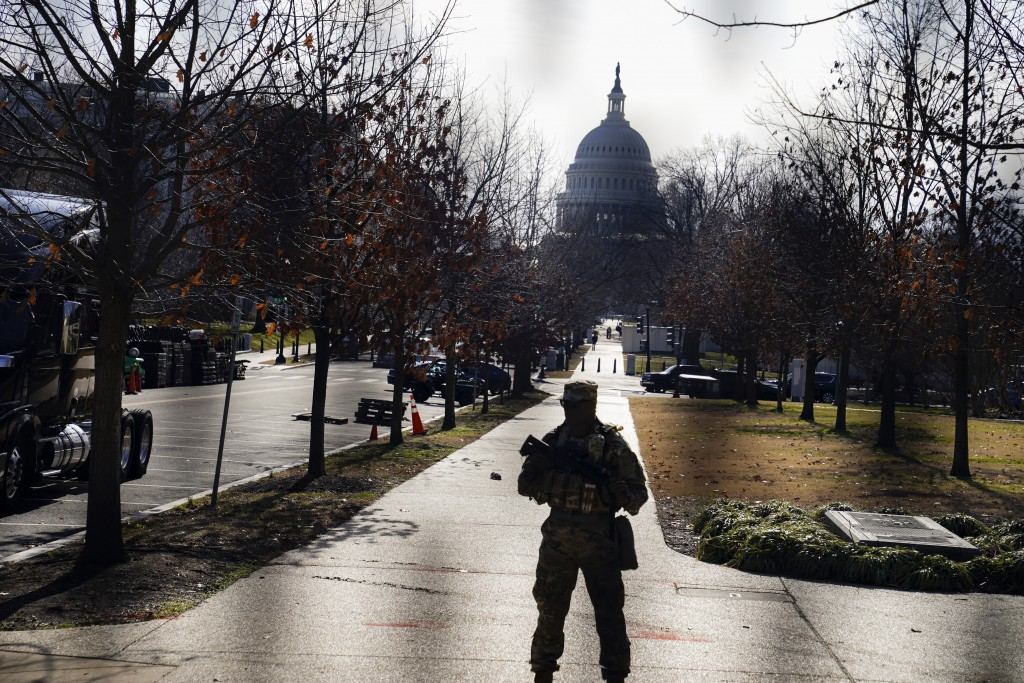 The U.S. Capitol is seen through security fencing on Saturday, Jan. 16, 2021, in Washington as security is increased ahead of the inauguration of Pres...