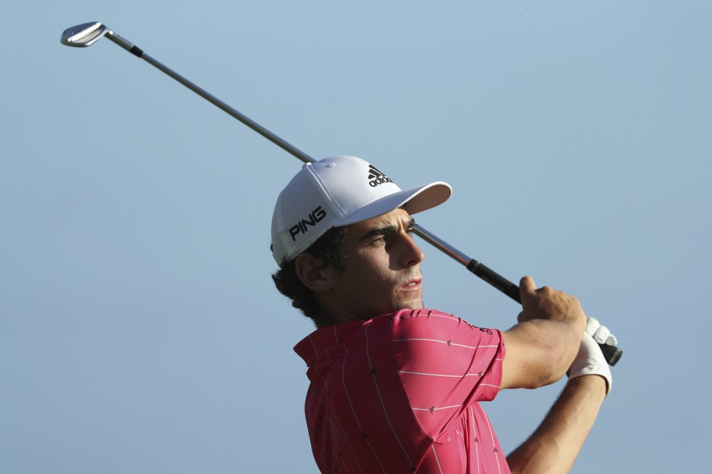 Joaquin Niemann, of Chile, follows his shot off the 17th tee during the third round at the Sony Open golf tournament Saturday, Jan. 16, 2021, in Honol...
