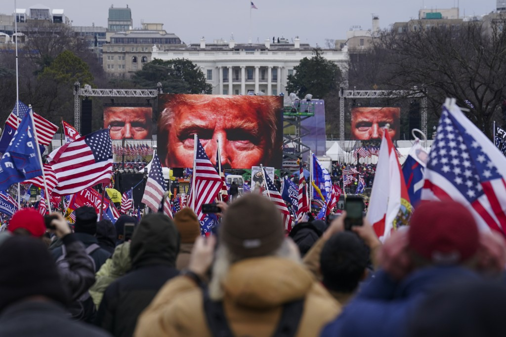 FILE - In this Jan. 6, 2021 file photo, Trump supporters participate in a rally in Washington.  An AP review of records finds that members of Presiden...