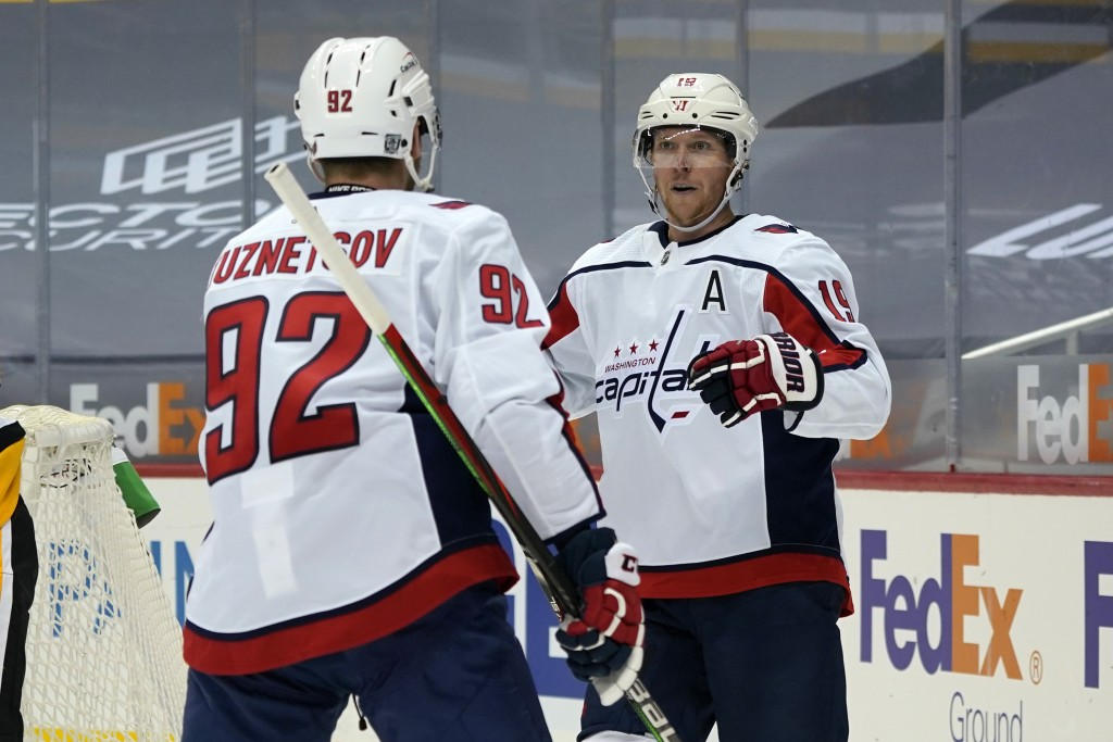 Washington Capitals' Nicklas Backstrom (19) celebrates his goal with Evgeny Kuznetsov during the second period of an NHL hockey game against the Pitts...