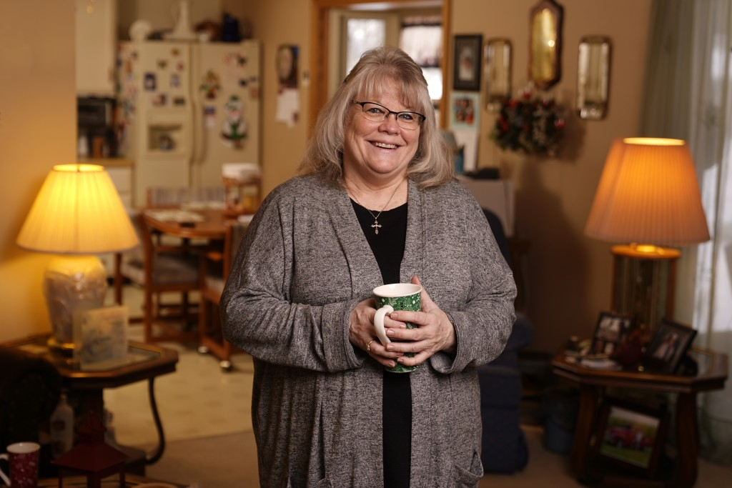 Sandy Atkins poses in her mother's home in Warsaw, Ind., Dec. 17, 2020. Atkins, 59, never voted for president -- until 2020, when the self-described C...