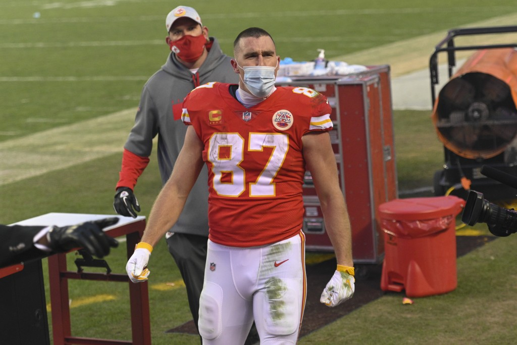 Kansas City Chiefs tight end Travis Kelce celebrates after an NFL divisional round football game against the Cleveland Browns, Sunday, Jan. 17, 2021, ...