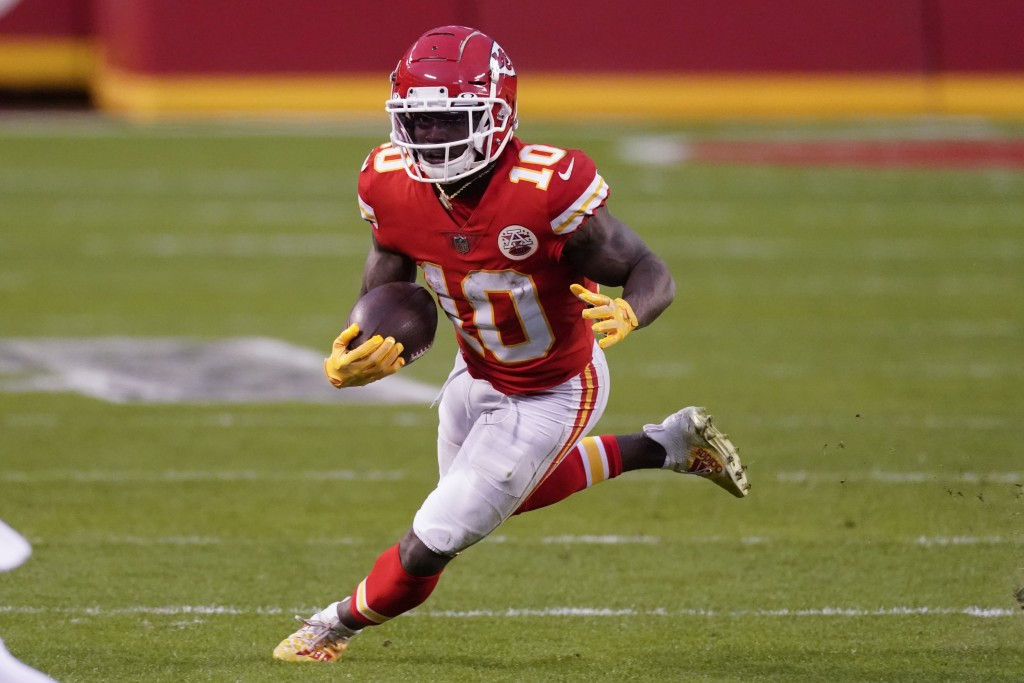 Kansas City Chiefs wide receiver Tyreek Hill runs up field after catching a pass during the second half of an NFL divisional round football game again...