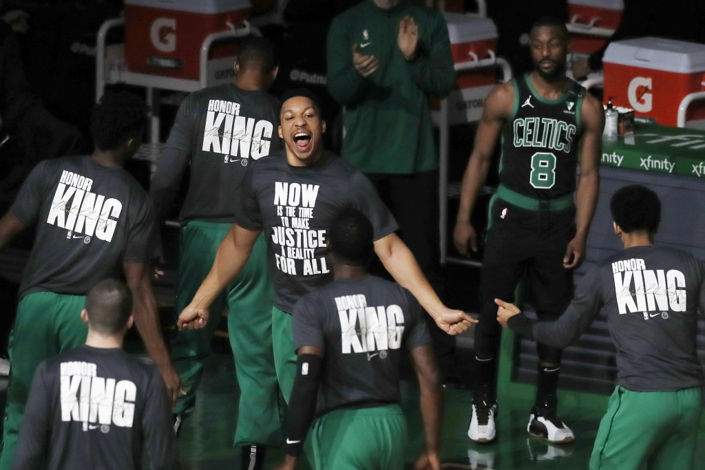 Boston Celtics' Grant Williams, center, rallies with teammates before an NBA basketball game against the New York Knicks, Sunday, Jan. 17, 2021, in Bo...