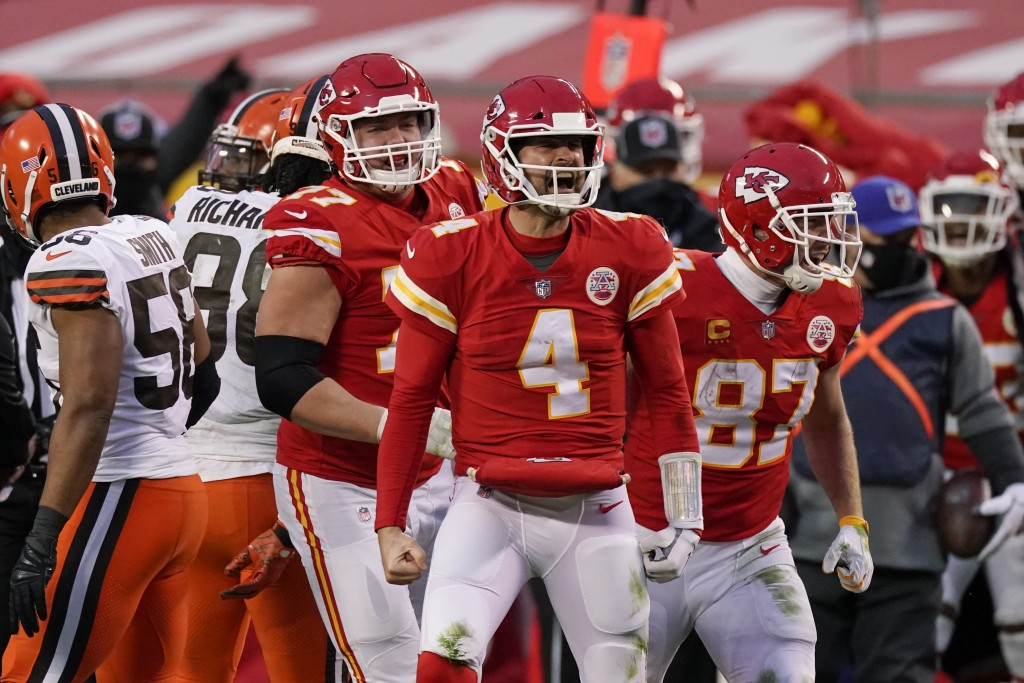 Kansas City Chiefs quarterback Chad Henne celebrates after a run during the second half of an NFL divisional round football game against the Cleveland...