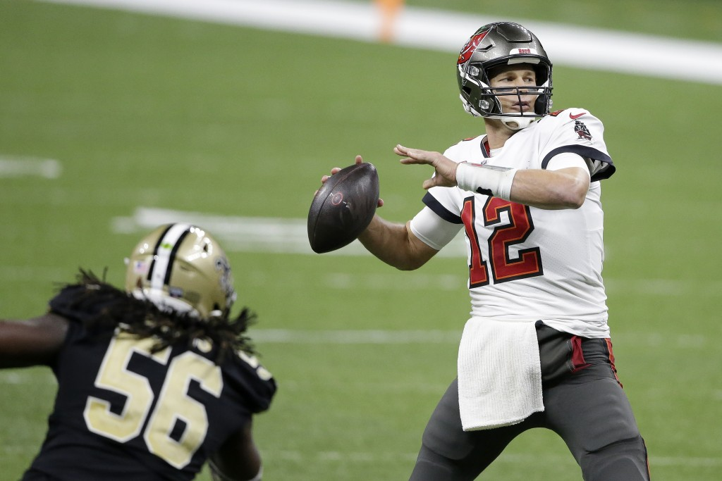 Tampa Bay Buccaneers quarterback Tom Brady (12) passes in front of New Orleans Saints outside linebacker Demario Davis (56) during the second half of ...