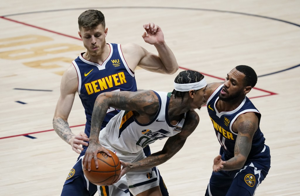 Utah Jazz guard Jordan Clarkson, front left, is trapped in the corner with the ball by Denver Nuggets guard Monte Morris, front right, and center Isai...
